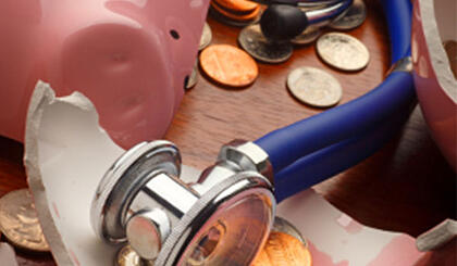 Stethoscope and Broken Piggy Bank