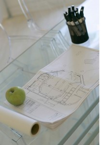 Architectural Design Drawing topped by a green apple