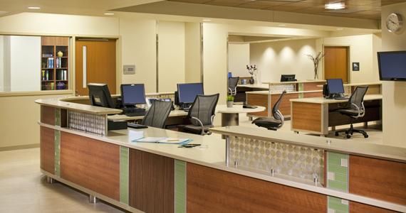Centralized Nurse Station with Custom Millwork Array Architects