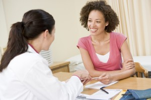 Happy Patient Speaking with Female Doctor