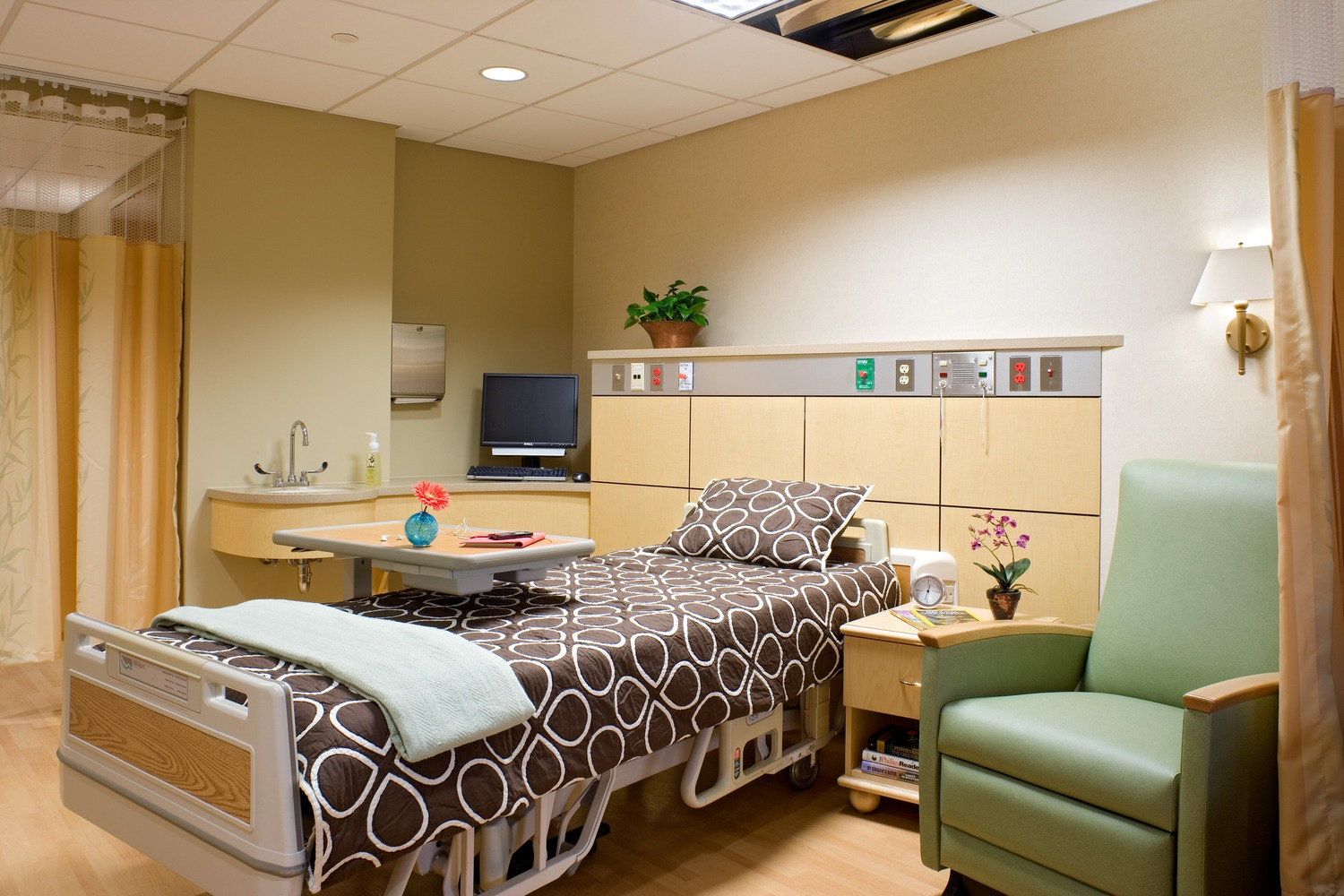 Private hospital room with headwall overbuild