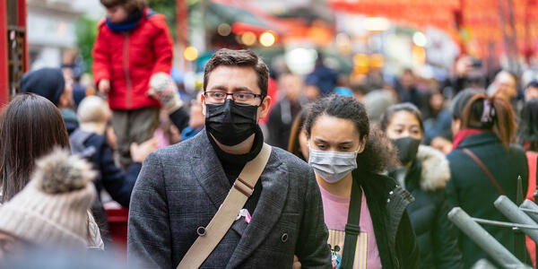 Two people with respirators avoiding Coronavirus exposure